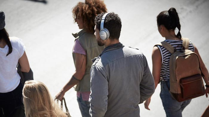 Image of QC35 on the man in crowd.