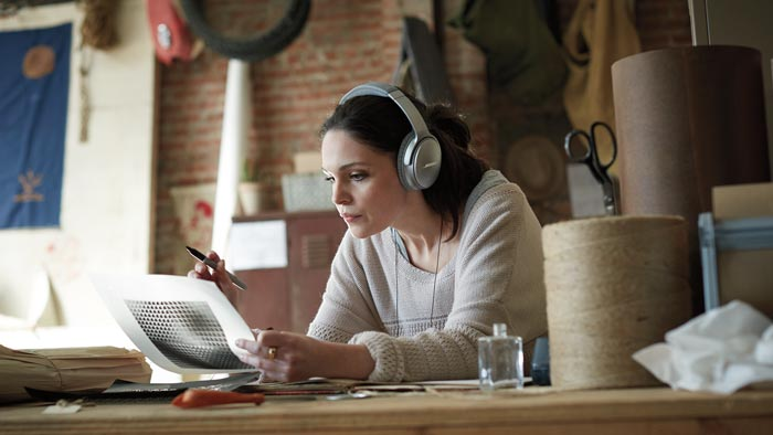 Image of QC35 on woman in design studio.