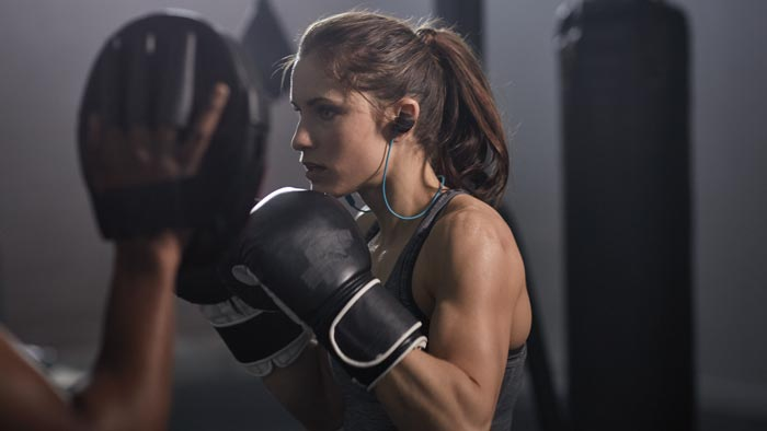 Image of SoundSport wireless worn by woman boxing.
