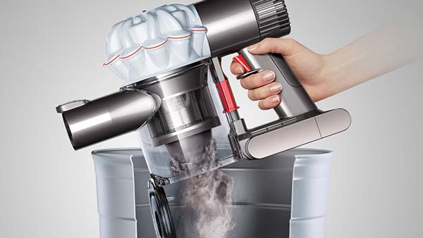image of Dyson V6 Vacuum emptying dustbin