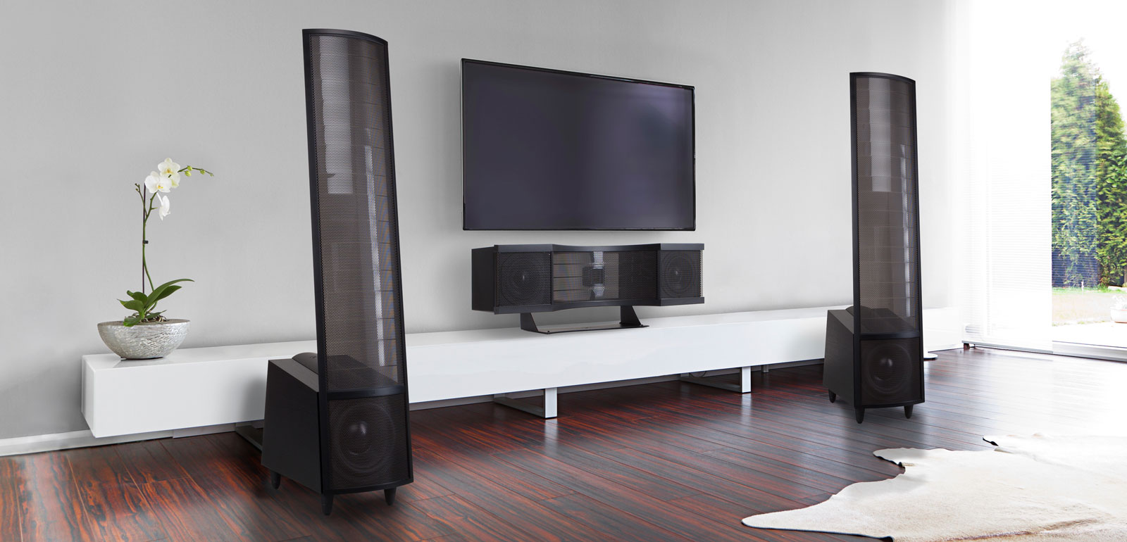 Lifestyle Picture of elaborate room with Martin Logan tower and Stage X center channel speakers
