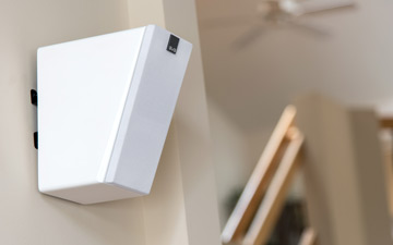 image of Elevate speaker mounted high on the wall.