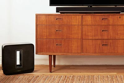 Feel the bass. Image of the Sonos Sub by TV cabinet
