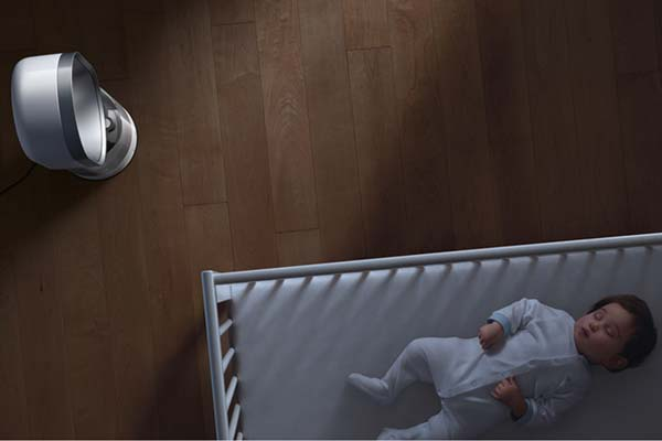 Image of child sleeping next to humidifier