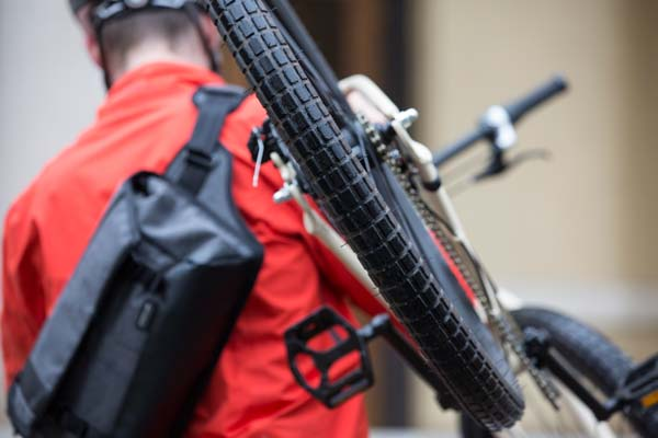 image of Lowepro Streetline SL 140 next to bike tire