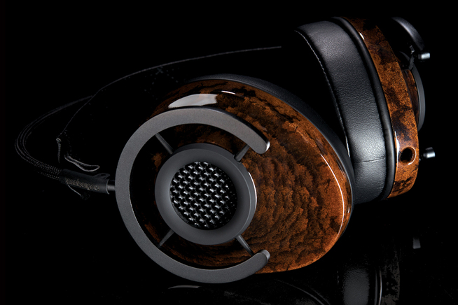 Ergonomics Design image of headphones on black surface.