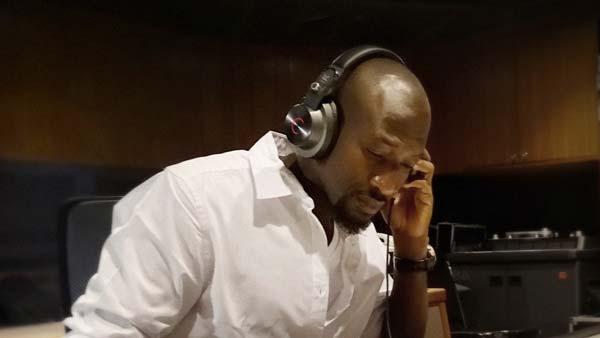 Man wearing Cleer DJ headphones in Studio