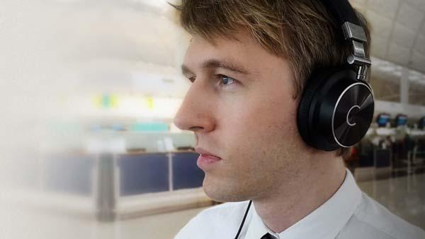Man wearing Cleer NC headphones on commute
