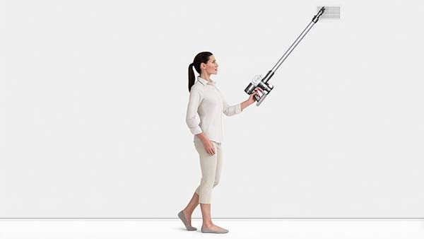 image of woman cleaning with Dyson V6 Vacuum