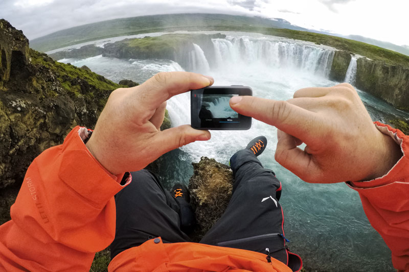Image of GoPro HERO6 screen with waterfall in background.