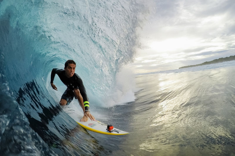 Image of GoPro HERO6 Black with man on surfboard.