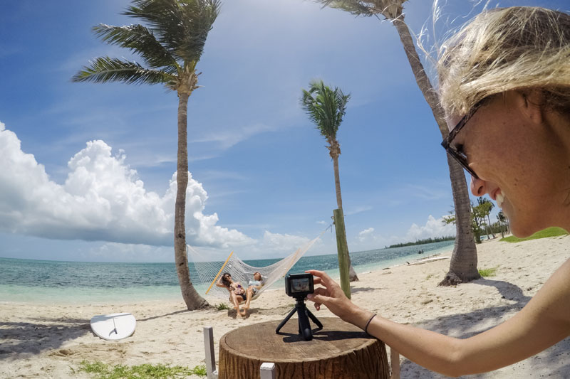 Image of GoPro HERO6 on beach with women on hammock.