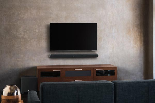 Image of SB 450 mounted on wall beneath television.